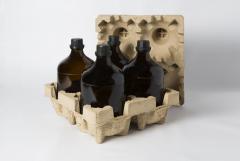 Nasávaná kartonáž - balení chemických lahví